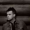 play music Robbie Williams